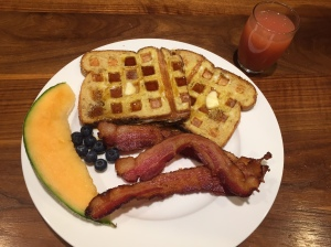 French Toast Waffles, with thick sliced bacon, melon, blueberries.  Always a hit with my guests.
