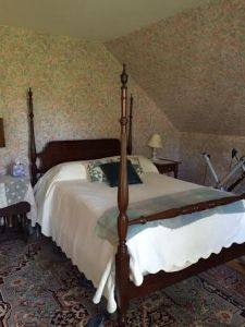 Antique four poster fullsize bed in the Master Bedroom.